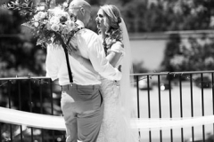 Black-and-white-photo-of-bride-looking-at-groom