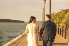 Bridge-and-groom-hold-hands-walking-away