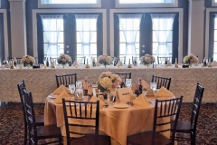 Wedding-table-place-setting-with-floral-bouquets-and-champagne