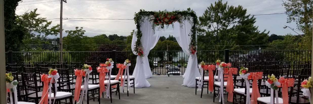 wedding arch and seats on the balcony